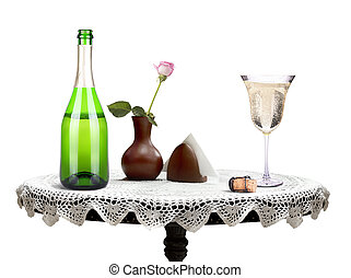 bottle of champagne and glass on a table - bottle of...