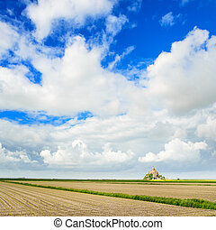 Mont Saint Michel monastery landmark and field. Unesco heritage site. Normandy, France, Europe.