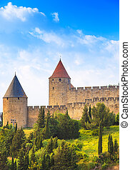 Carcassonne Cite, medieval fortified city on sunset...