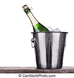 bottle of champagne in ice bucket - bottle of champagne in...