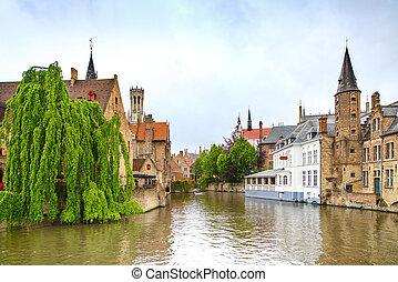 Bruges or Brugge, Rozenhoedkaai water canal view Belgium -...
