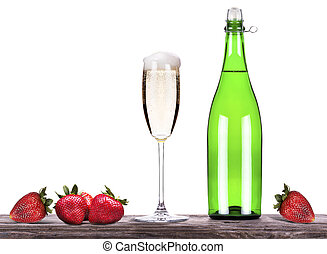 strawberry with bottle of champagne and glass on a table -...
