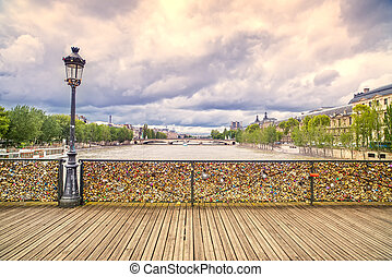 Love padlocks on Pont des Arts bridge, Seine river in Paris,...