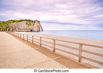 Etretat Aval cliff landmark, balcony and beach under a...