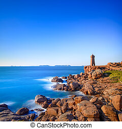 Ploumanach lighthouse sunset in pink granite coast,...