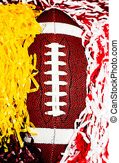 American Football and Pom Poms - Closeup of American...