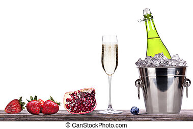 summer fruits and ice bucket with champagne - strawberry,...