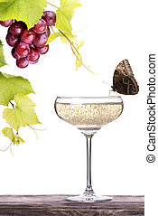 grapes with glass of champagne on a table - grapes,...