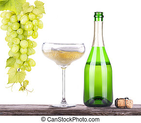 grapes with bottle of champagne and glass - grapes with...