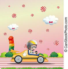 A boy riding on a car