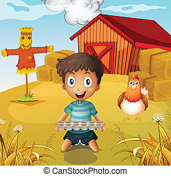 A boy holding an empty egg tray at the farm with a scarecrow...