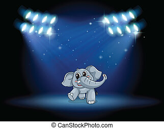 An elephant dancing at the stage under the spotlights -...