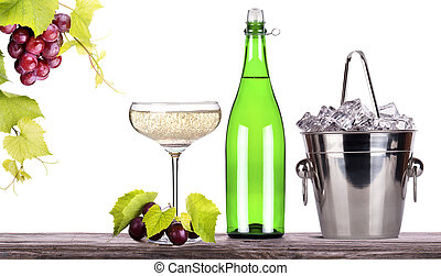 grapes, ice bucket with champagne on a table - grapes, ice...