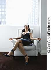 Woman relaxing in chair.