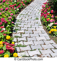 causeway and colorful flower bed