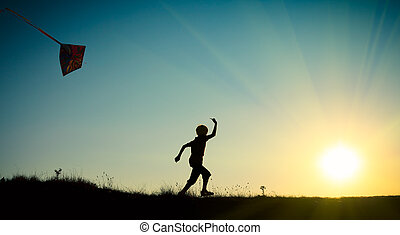 Child running with a kite - A child running with a kite...
