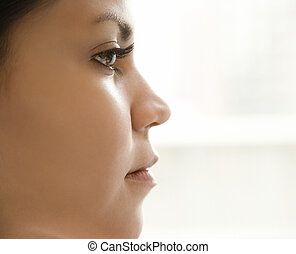 Profile of womans face - Close up profile of Hispanic young...