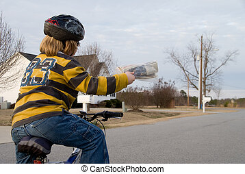 Newspaper Delivery - A boy delivering newspapers on his...