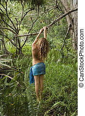 Woman in nature. - Topless Caucasian young adult woman...