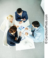 Negotiations - Above view of successful partners during...