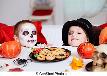 Halloween treats - Photo of two eerie boys looking at...