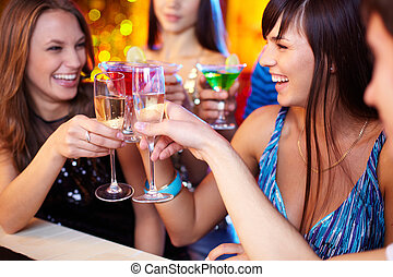 Friends toasting - Portrait of joyful friends toasting at...