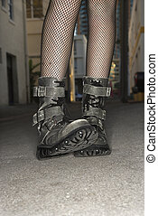 Woman wearing boots. - Legs and feet wearing boots of...
