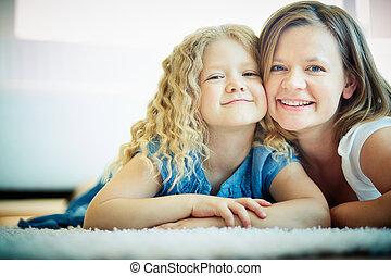 Togetherness - Portrait of happy woman and her daughter...