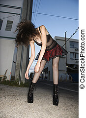 Woman flinging hair.
