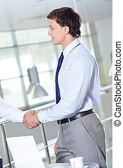 Business agreement - Portrait of businessman handshaking...