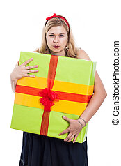 Greedy woman with present - Greedy woman holding big...