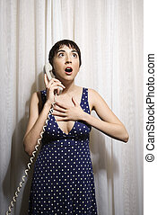 Woman on telephone - Pretty Caucasian young woman holding...