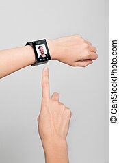 female wrist with a modern Internet Smart Watch - Female arm...