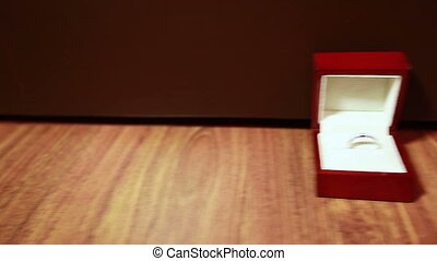 Wedding rings in a box - Camera on the dolly moves past the...