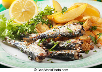 Grilled sardine fish with potato wedges - Grilled sardine...