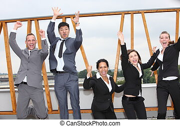 Successful business team cheering and rejoicing - Successful...