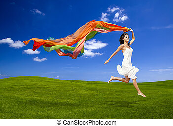 Jumping with a colored tissue - Beautiful woman running and...