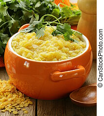 side dish of yellow lentils with herbs and spices