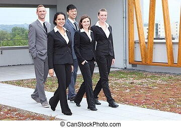 Stylish young business team walking together - Stylish young...