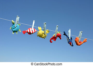 Cute sea creatures - Colorful sea animal toys hanging on the...
