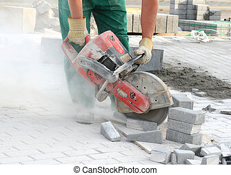 Dangerous work - Close look at the worker with concrete saw...