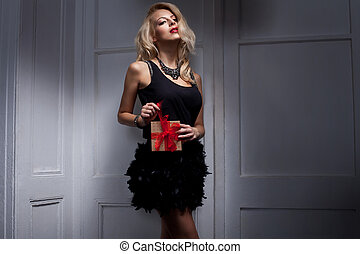 Sexy blonde woman with a gift