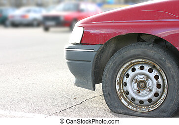 Flat tire - Old useless red car with flat tire