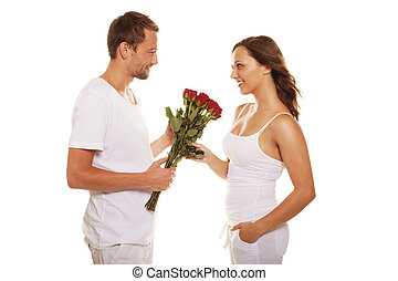 Husband offering a rose to his happy wife