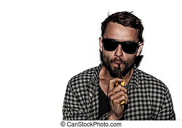 man smoking e-cigarette wearing sunglasses