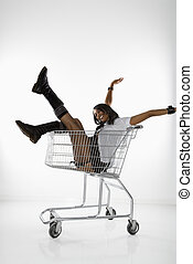 Woman in shopping cart.