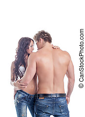 Embrace of semi-nude couples posing in jeans, isolated on...