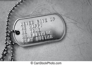 Dog tag mantra - Words to live by inscribed on a dog tag