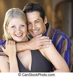 Caucasian couple smiling - Caucasian mid adult couple...