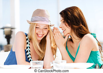 girls gossiping in cafe on the beach - summer holidays and...